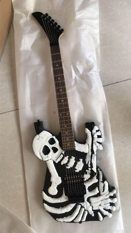 özelleştirilmiş hizmet veren Özel toptan yeni espmodel imza gravür siyah kafatası elektro gitar,