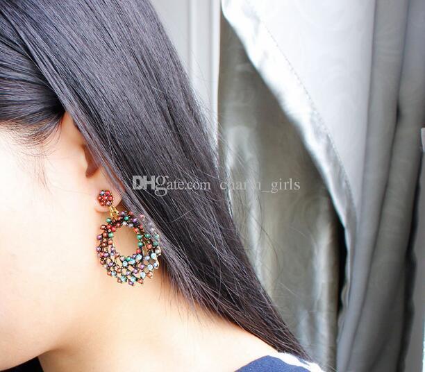 nouvelle boucle d'oreille de bohème chaud européen et américain de style rétro couleur perles de riz creusant pendentif mode classique élégant
