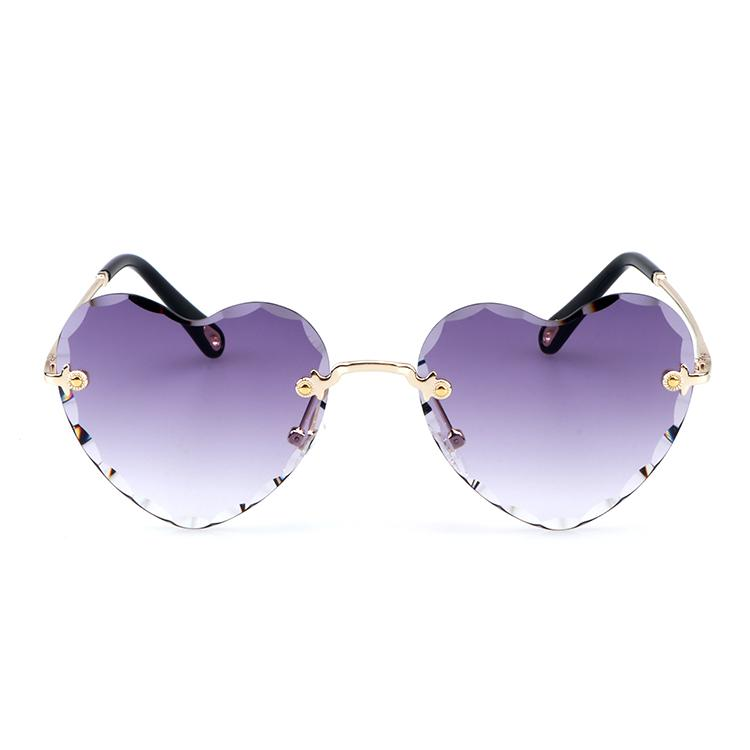 Selling fast trendy rimless sunglasses heart shaped metal temples new products uv400 sun glass for Women