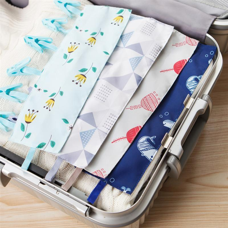 OUNONA Portable Clothes Hangers Folding Sticky Clothes Drying Rack with Plastic Clips Hook Holder for Bath Coat Cap Towel