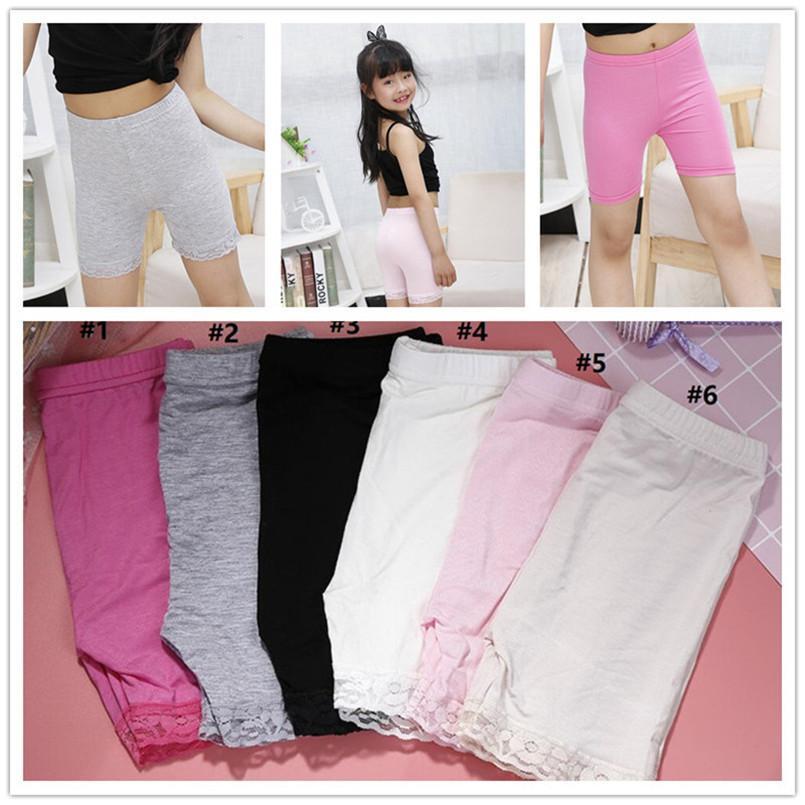 Seguridad niñas pantalones cortos de color sólido de la ropa interior de encaje corta legging Pantalones elástico suave polainas del algodón niñas calzoncillo retro cortos E3303 calientes