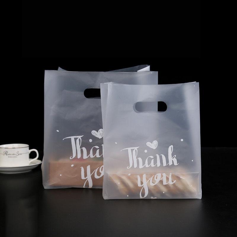 50pcs Thank You di plastica regalo sacchetto di tela di immagazzinaggio Shopping Bag con manico in plastica festa di nozze Candy Cake confezionamento di sacchetti
