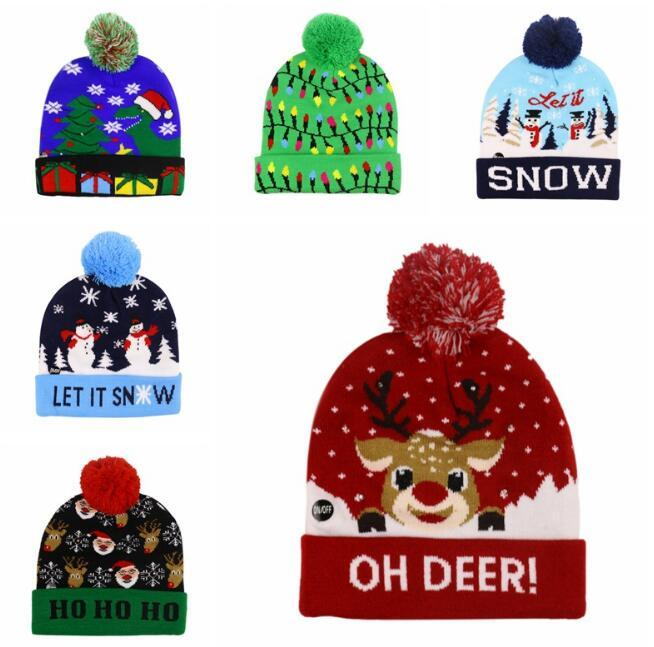 Natale Stoffe Cappelli LED del bambino dei capretti dello scaldino di inverno Berretti Crochet del fumetto Caps regalo decorazione del partito di natale 10 stili 2019