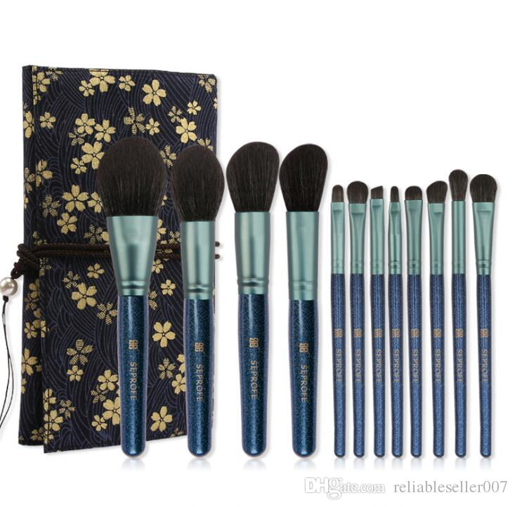 In Stock Newest 12pcs/Set Makeup Brushes high quality nylon wool soft and skin friendly with printing Brush package free shipping.