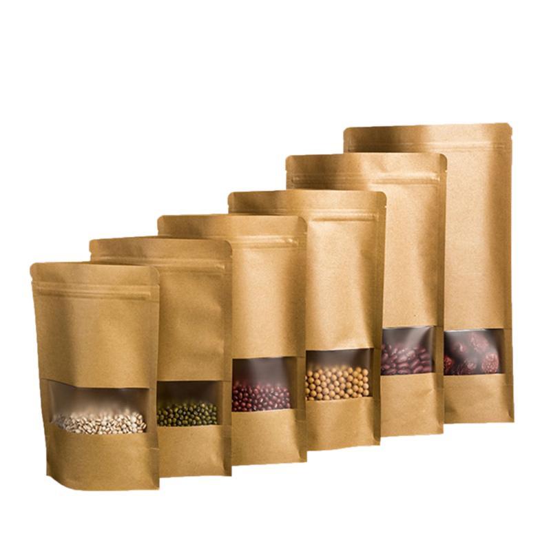 100pcs papel Kraft se levanta bolsa de la cremallera bolsa resellable con ventana Zip Heat Seal cierre de bloqueo para el envasado de alimentos