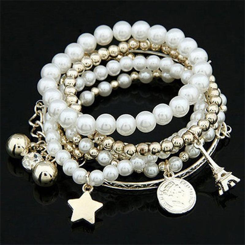 6PCS / SET coreana Moda Multi-strati di monili del braccialetto di disegno delle donne dell'annata alta elastico imitazione Pearl BRACCIALI