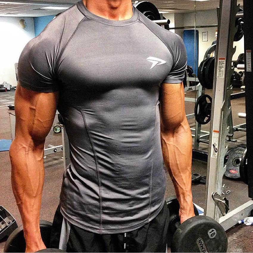 2019 GYM Camiseta Deportiva Camiseta Hombres Rashgard Ajuste de Secado rápido Camiseta Corriente Hombres Camiseta de Fitness Ropa Deportiva Elástica Camiseta de Baloncesto