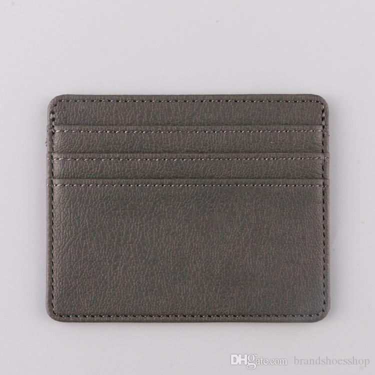 Wholesale 2019 Short Fashion Card Holders Sale New Style men women Cheap White Black Wallet Free Shipping 002-A1