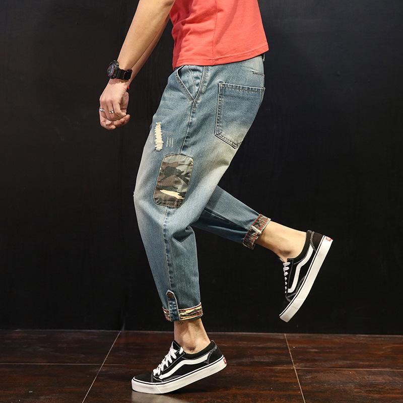 libero marea di moda i jeans degli uomini di trasporto casuali 2019 quattro stagioni jeans uomo piedi allentati dei pantaloni degli uomini di colore