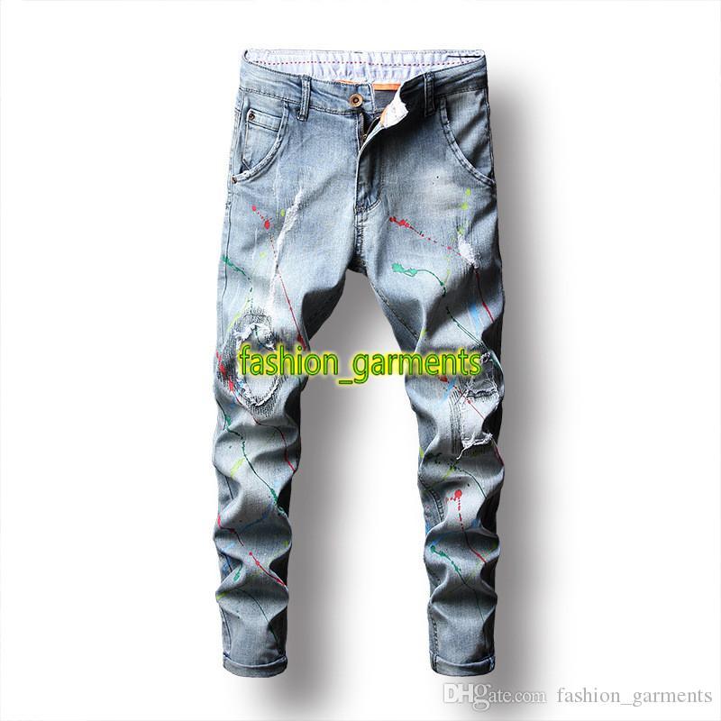 La nueva manera de la pintada del agujero de los pantalones vaqueros para hombre auto-cultivo estilista estiramiento del lápiz de los pantalones vaqueros de Hip Hop Tide