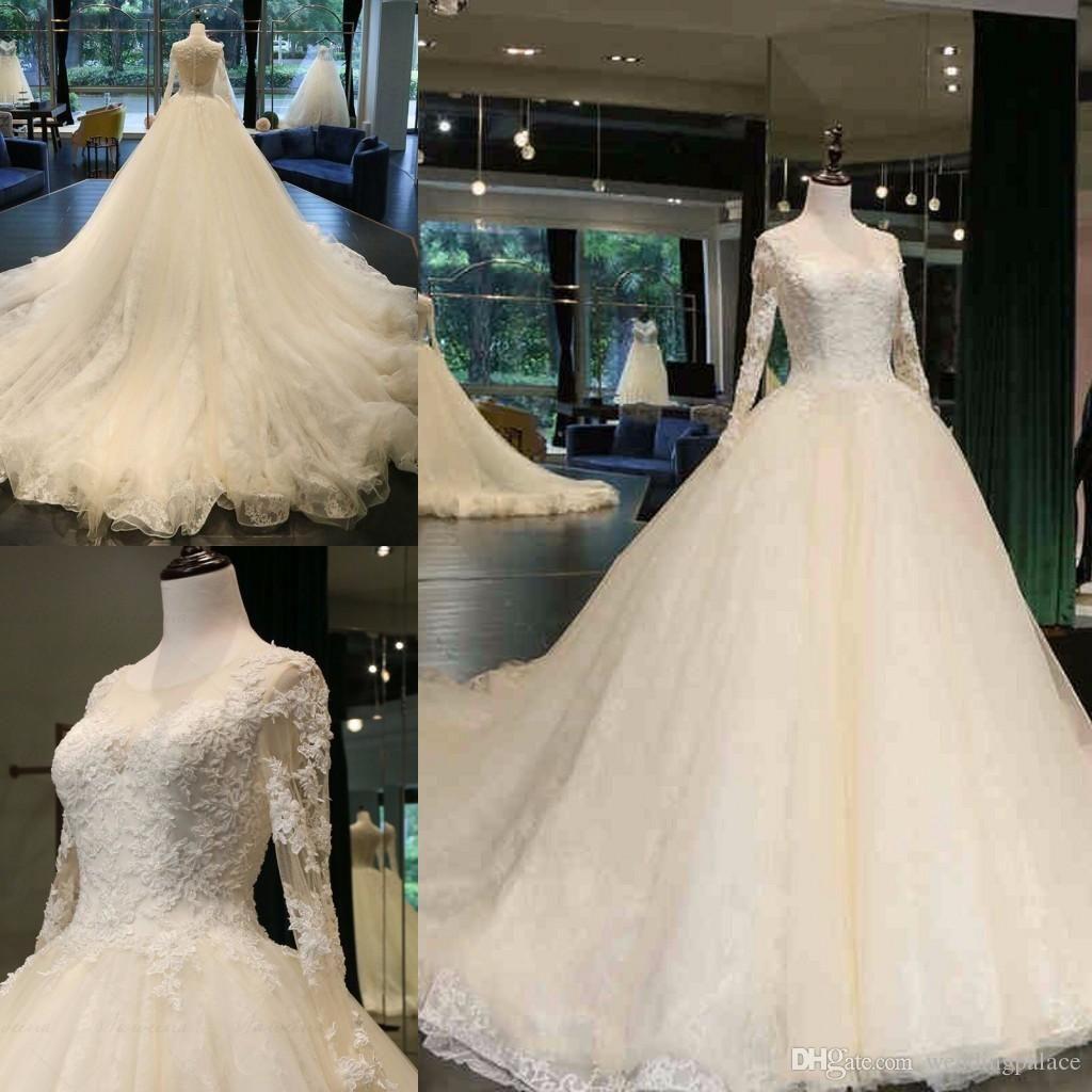 Os mais recentes Jewel Neck A linha de vestidos de casamento Catedral Trem apliques de contas manga comprida Botão-se Voltar nupcial do casamento Vestidos
