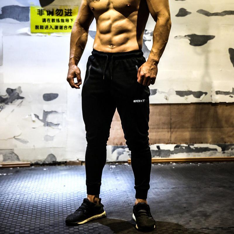 Corredores pantalón ocasional de los hombres flacos de gimnasios de entrenamiento pantalones de la marca de pista de invierno otoño masculinos de algodón pantalones de deporte