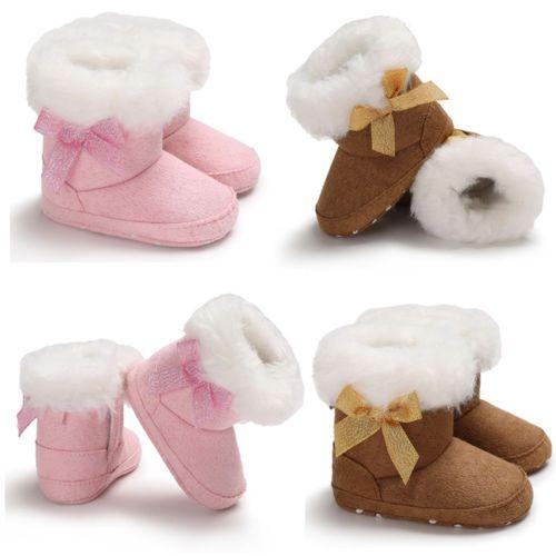Nueva felpa del invierno grueso de arranque Kid caliente bebés del cargador de la nieve del Bowknot de los zapatos de algodón suave Sole cuna Los niños felpa botas