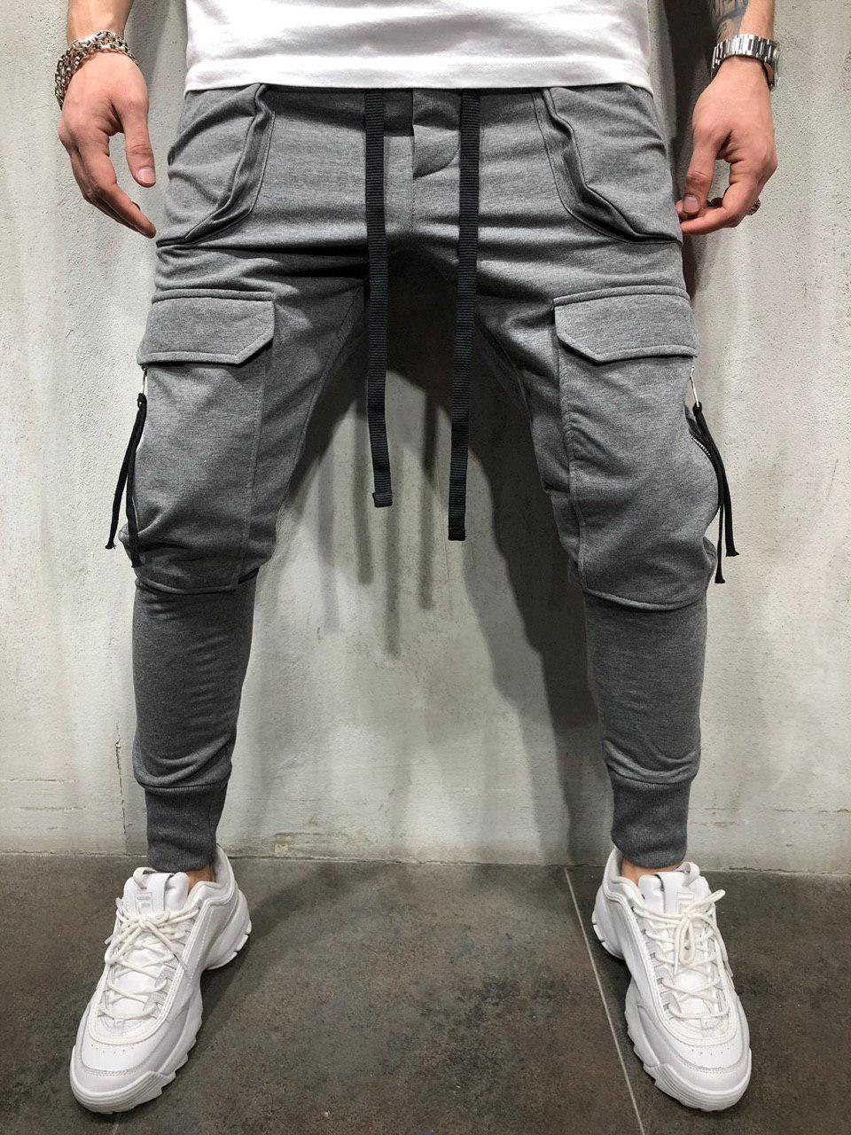 Harem pants Men Europe and America Leisure Multi-pocket Fitness Beam port Pants fashion zipper Patch pocket Slim fit Sweatpants new style