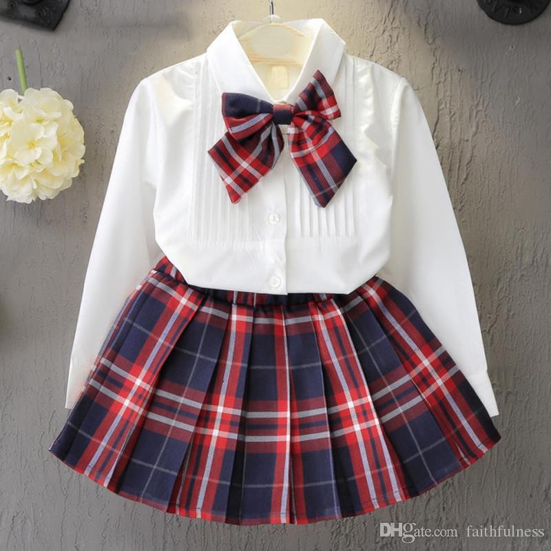 Vestido de niña Nuevos vestidos de princesa Uniformes de clase Niños Chicas Bow camiseta + Vestido a cuadros Ropa de disfraces para niños 2pcs