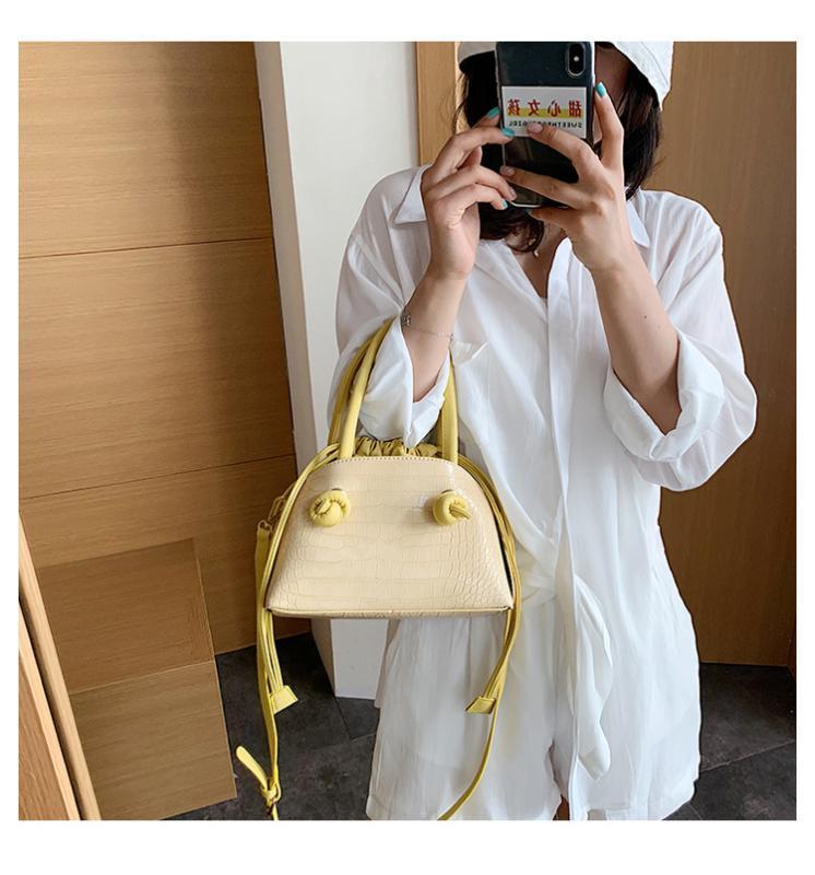 В начале лета 2020 минималистский новый стиль мода drawstring дикий плечо посланник сумки женщин кожаные сумки