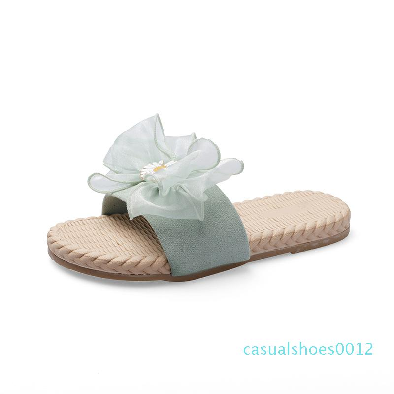 2020 Sommer neue Luxus-Designer-Bogen kleine Daisy kühlen flache Hausschuhe weibliche wilde Outdoor-Freizeit-fashion fee Wort Sandalen c12