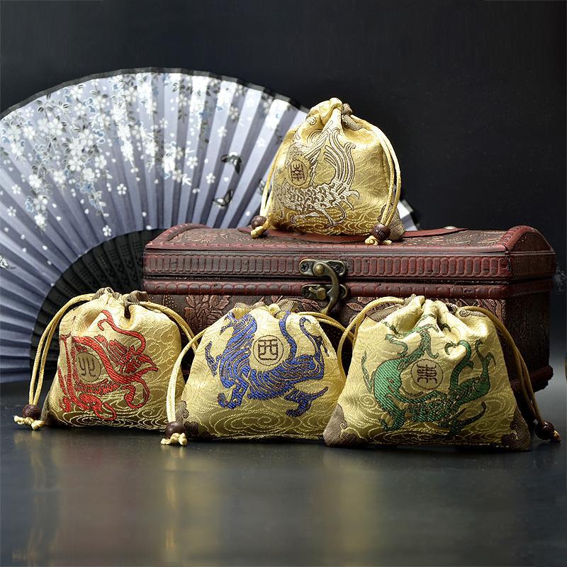 جودة عالية صغيرة الرباط النسيج يونيكورن هدية حقيبة عيد الميلاد الصينية الحرير الديباج مجوهرات الحقيبة الوحش كاندي حقيبة 10 قطعة / الوحدة