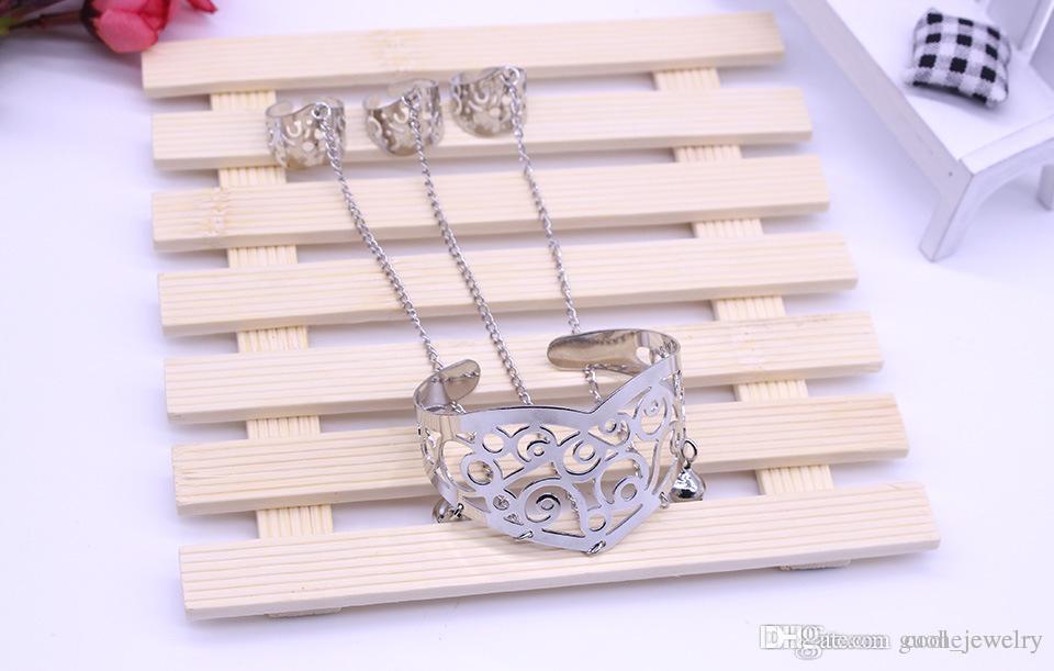 Pulseras para las mujeres Retro tallado hueco pulseras esclavas borla cadena un anillo de tres dedos pulseras envío gratis