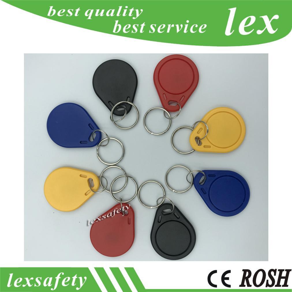Prix le moins cher usine 100pcs make TK4100 de 125kHz / lot ISO11785 ABS étiquettes RFID clés en plastique de couleur personnalisée