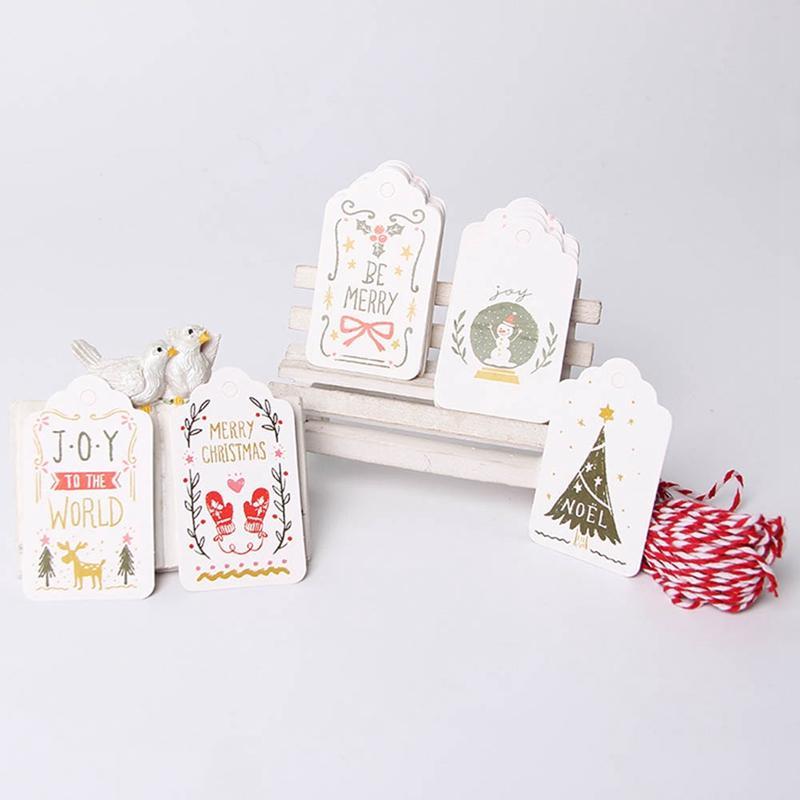 50pcs / lot Joyeux Noël bricolage unique cadeau de houx Mots clés Jolly Tag petite carte en option chaîne de bricolage Craft Étiquette Party décor avec corde