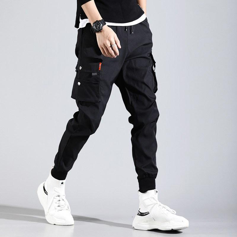 الهيب هوب الرجال pantalones Hombre High Street Kpop السراويل البضائع عارضة مع العديد من جيوب ركض موديس الشارع الشهير بنطلون المتناثرة