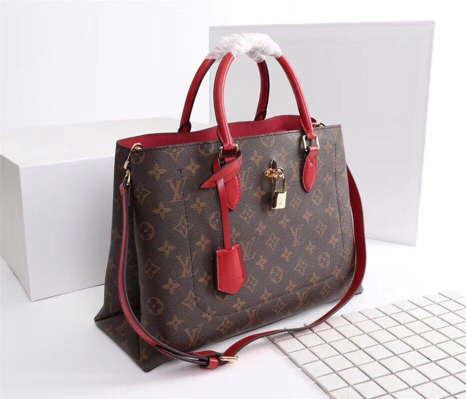 Yeni Yüksek uç kaliteli varış ünlü Marka Klasik tasarımcı yeni moda kadın veya erkekler haberci çanta çapraz vücut çanta okul sırt çantaları M43550