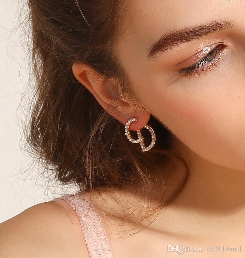 Hommes de haute qualité Mode féminine acier 316L de titane rose 18 K boucles d'oreille en argent lettre d'or pour les filles bijoux garçon gros Noël