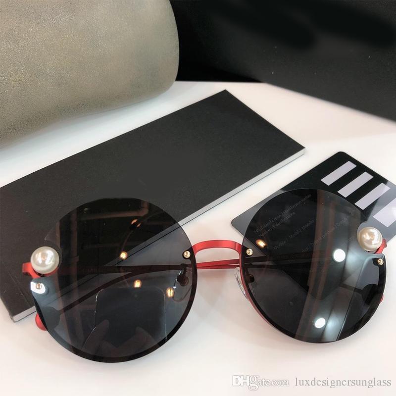 Kadınlar için 2183 Lüks Güneş Gözlüğü Çerçevesiz Yuvarlak Güneş Gözlüğü UV Koruma Lens Sürüş Seyahat için Kutusu ile Gel