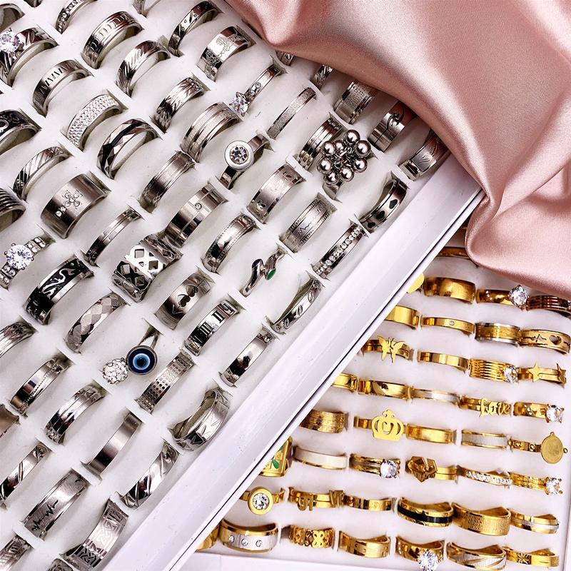 Alla moda 30 pz / lotto anelli in acciaio inox anelli in acciaio inox band titanio stile dorato argentato uomini e donne wedding beautiful gioielli fascino partito regalo