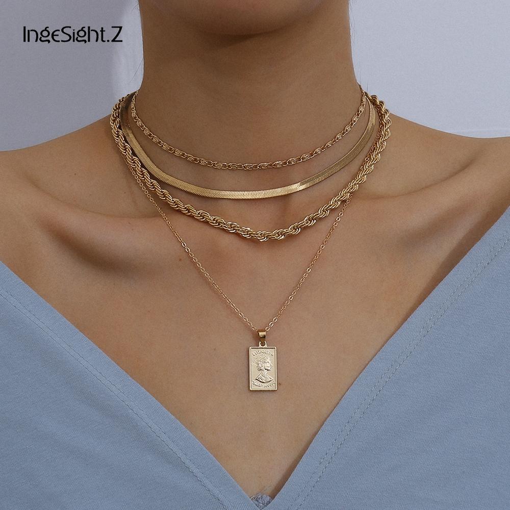 Ingesight.z 4pcs / set Multi Layer Twisted Metal-Seil-Ketten-Halsketten-Weinlese geschnitzte Münze Porträt-Anhänger Halskette Schmuck