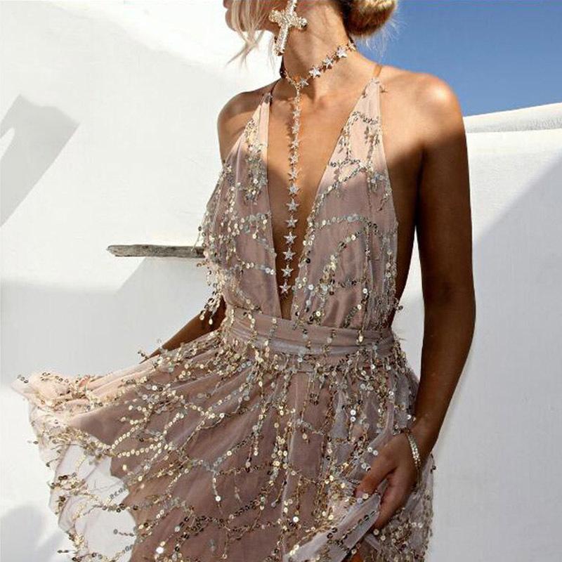 atractiva mujer con lentejuelas vestidos sin espalda halter Negro Oro partido del mini vestido de 2019 nuevas llegadas borla de verano T200707 vestido del club desgaste