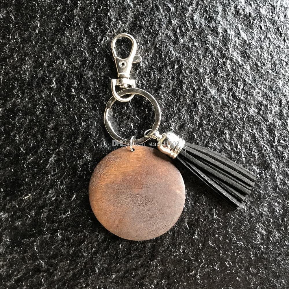 Venta caliente clásico pequeño MOQ personalizado disco de madera corchete llavero monogrammed madera en blanco redondo con borla negro llavero