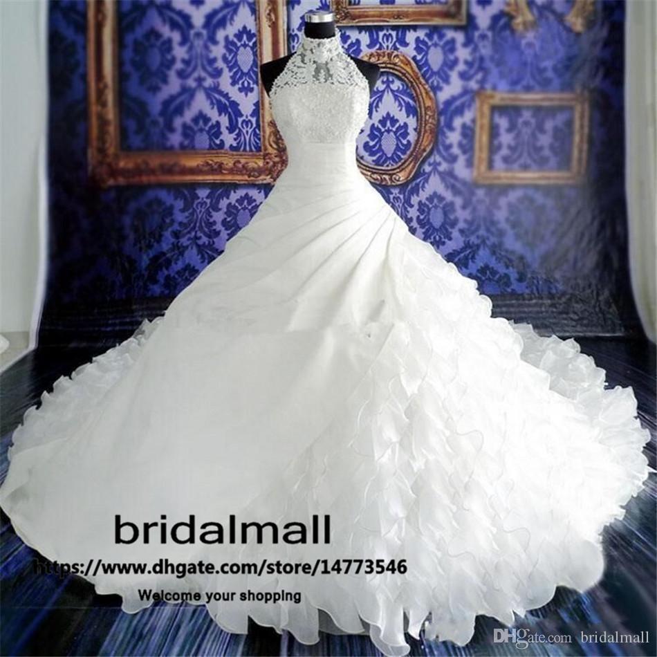 2020 Modeste dentelle robes de mariage Appliques robe de bal Halter Robes de mariée volants niveaux train chapelle Une ligne Robes de mariée Robes de mariée