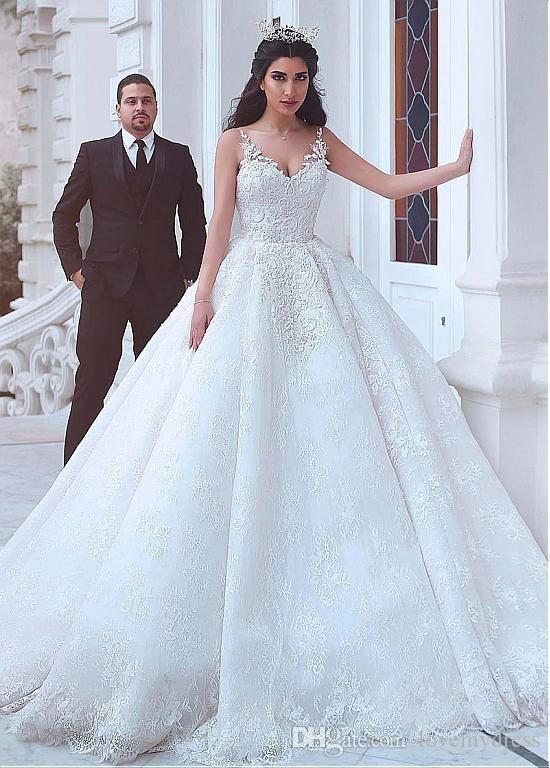 2020 Alluring Saudi Arabic African Ball Gown Wedding Dresses Empire Waist Lace Applique Beaded Spaghetti V-neck Open Back Bridal Vestidos