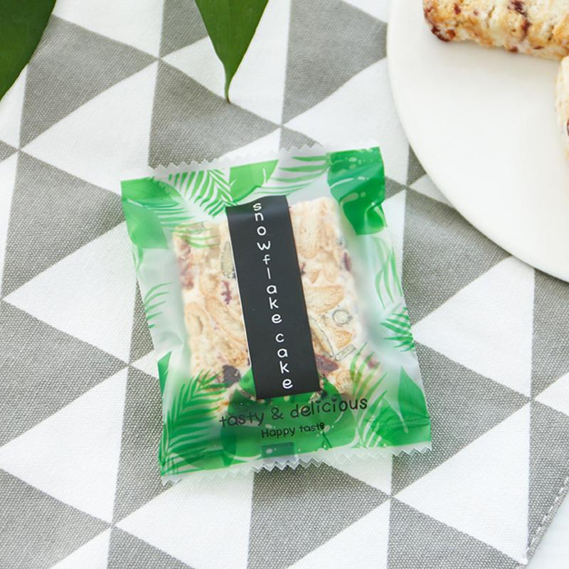 100pcs DIY Biscuit Crisp cake Packaging Bag Small Fresh Green Flamingo Letter Leaves pattern kitchen Seal Bag Plastic Bags