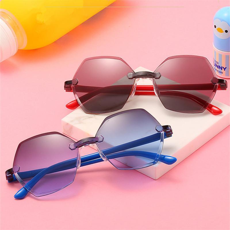 جدي جديد البلاستيك نظارات بدون إطار إطار نظارات بنات بنين الطفل النظارات الشمسية العلامة التجارية المحيط الأطفال نظارات شمسية هلالية UV400