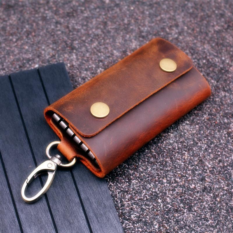 Handmade genuino degli uomini raccoglitore chiave del cuoio Keychain del supporto del sacchetto di borsa cerniera Designer Uso delle auto piccole caso chiave chiavi di custodia