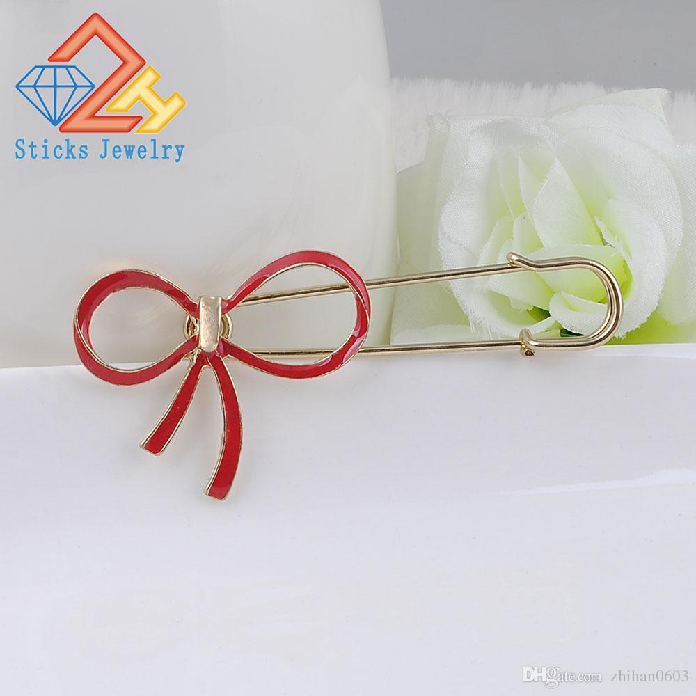 Spilla in lega d'oro con fiocco in cristallo di alta qualità per donna