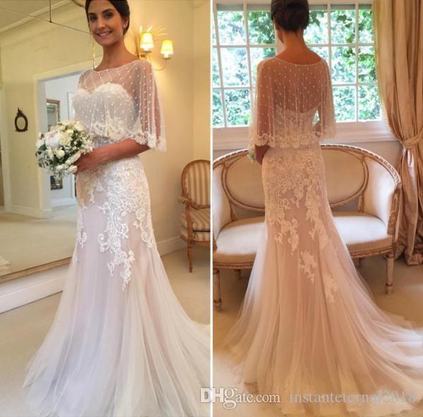 2020 Arabe Une ligne Robes de mariage Illusion avec Wrap demi-manches en dentelle de perles Backless Appliques Taille Plus balayage train Tulle Robes de mariée