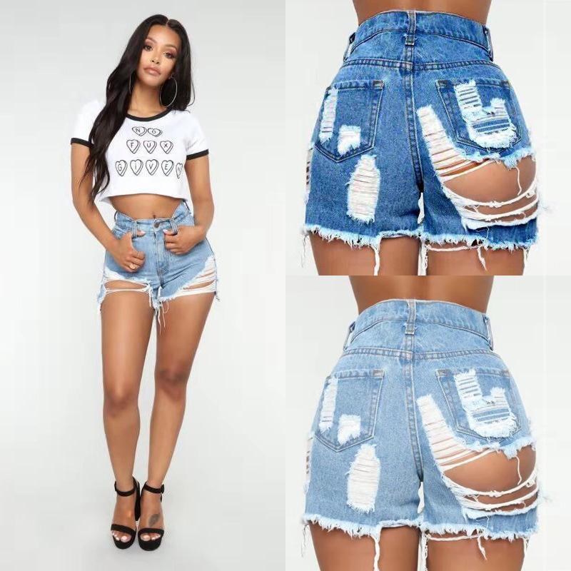 Los nuevos pantalones vaqueros de la calle atractivo vestido de la mujer de cintura alta pantalones vaqueros rasgados verano Mar shorts de playa del club nocturno atractivo de la mujer