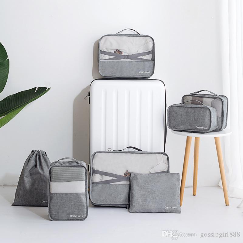 Borsa da viaggio in sette pezzi Bagaglio da viaggio Valigia Bagaglio di grande capacità Abbigliamento impermeabile Pacchetto di imballaggio e finitura