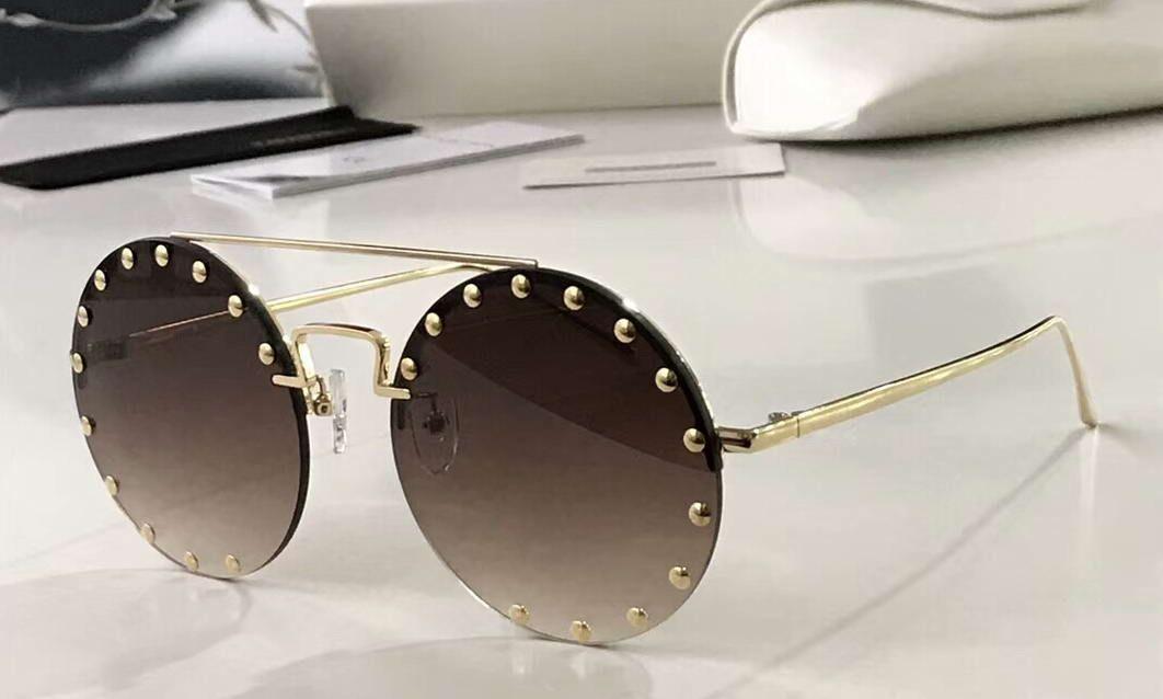 Шипованные Круглый Rimless Солнцезащитные очки Gold / Brown Затенение объектива Солнцезащитные очки Женщины Модные солнцезащитные очки Новый с коробкой