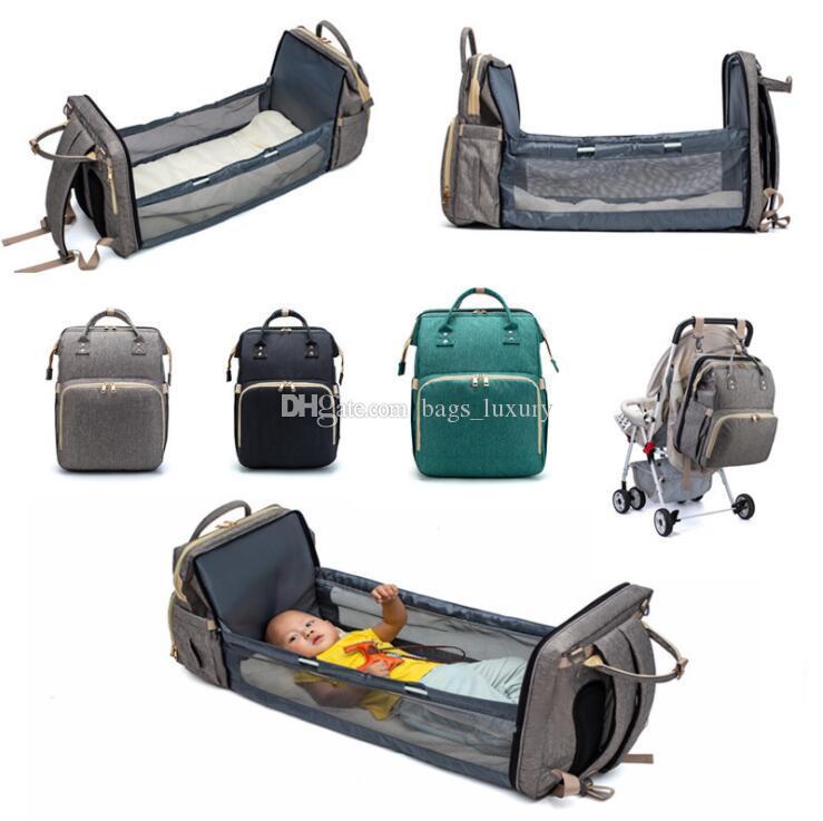 2021 Nouveau Voyage Sac à dos portable pliable maman multi-fonction à grande capacité mère couches pour bébés Sac à dos avec des sacs de couchage de lit
