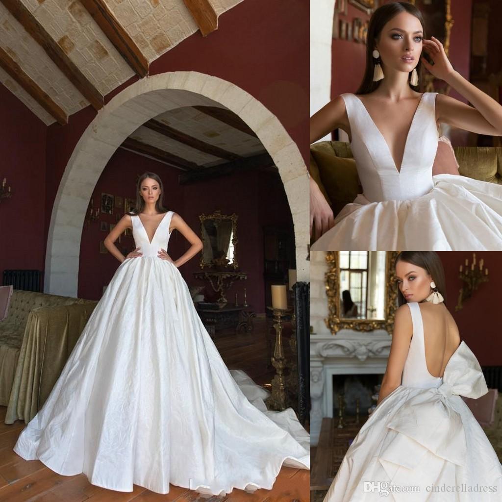 2020 Eva Lendel Bohemian Ball Gown Wedding Dresses V Neck Backless Sleeveless Sweep Train Country Bridal Dress Bow Plus Size Wedding Gown