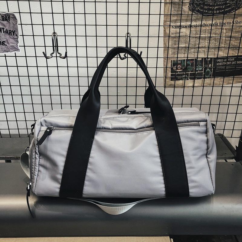 Nuevo bolso multifunción gimnasia para hombres y mujeres de gran capacidad viaje Mujer bolsos de mano de la manera del gran bolsa de lona masculino Deporte equipaje