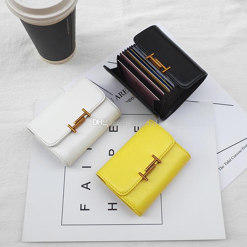 Nouveau titulaire de la carte d'affaires en cuir véritable concepteur femmes ID carte de crédit Case Pocket grande capacité Porte-monnaie femelle / mâle portefeuille de haute qualité