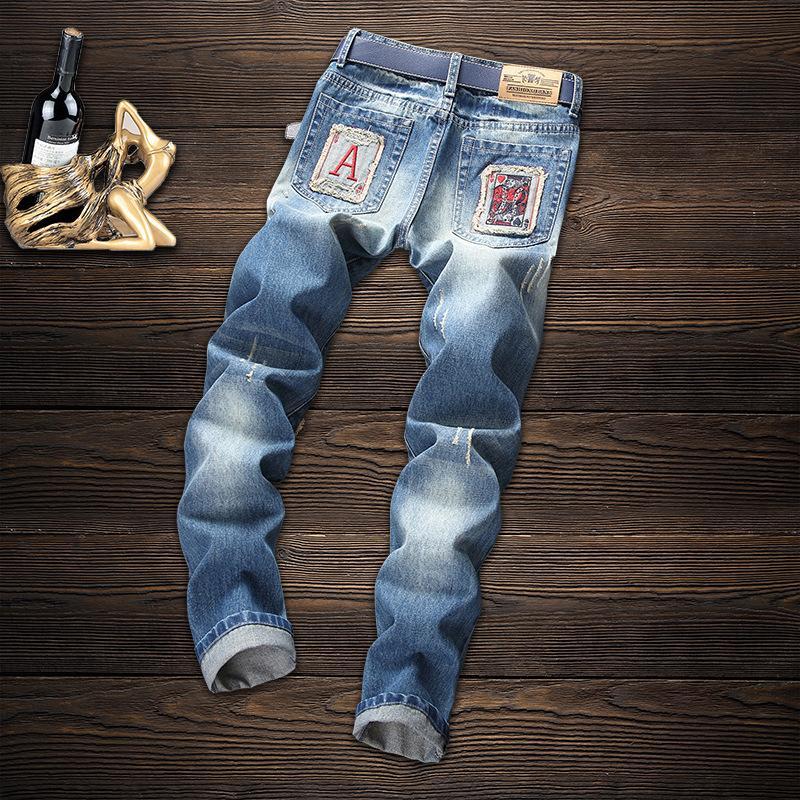 mens transfronteriza nueva marca de moda los pantalones vaqueros para hombre de huecos de Europa y América parches bordados azules straighttube pantalones vaqueros cuatro estaciones