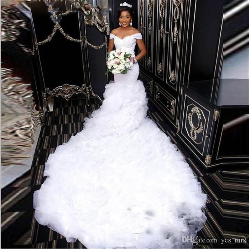 2020 New Sexy African Mermaid Wedding Dresses Off Shoulder Lace Appliques Beaded Crystal Tiered Ruffles Open Back Chapel Train Bridal Gowns