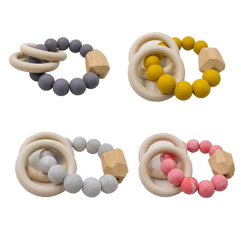 New Natural Teethers anel de madeira para Baby Care Saúde Acessórios infantil Fingers Exercício brinquedos coloridos Silicon frisada Soother A10044